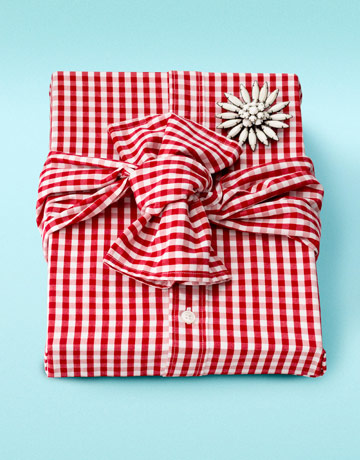 For the clothes horse, wrap one gift with another one, such as a shirt. You can make it extra fancy by fastening a brooch instead of a bow.  Source