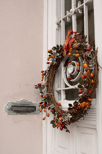 Don't abandon that more Autumnal-looking wreath. This rosehips wreath looks fabulously Christmas-ready. If you want to update the look even more, try tying the wreath with a wide, red velvet ribbon. Source:  Flickr User Rich B-S