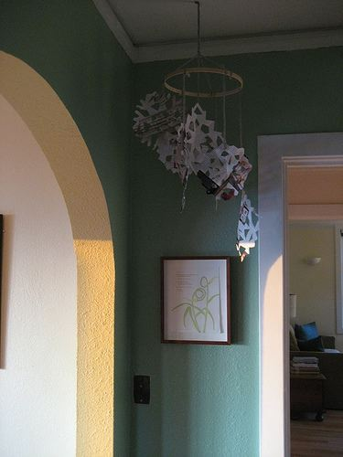 Want to decorate with snowflakes in your home? Try this easy snowflake chandelier.
