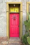 Consider painting your door bright red to celebrate the season. Source