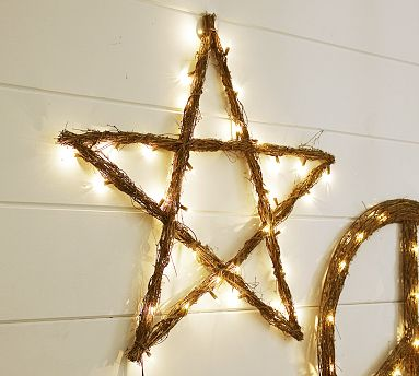 Using twigs, greenery, or even tinsel, create a star shape on your wall. Then wrap it with holiday lights to give it shine.