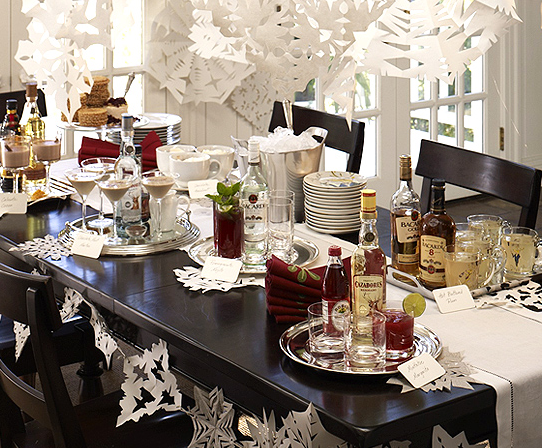 Cut-out snowflakes may be a grade-school craft, but they can still look sophisticated when you hang them en masse above your dining table like a chandelier.