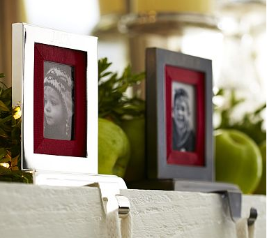 Give prominent framed photographs and artwork, especially ones on your mantel, a seasonal makeover by swapping in red or green mats for them.