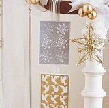 Hang cards from ribbon on your banister.  Source