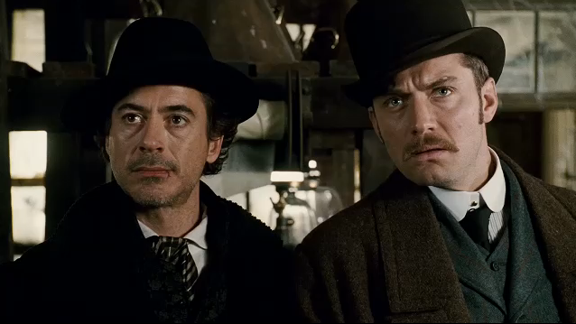 Holmes and Watson look dapper in their bowler hats.