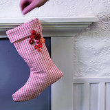 Hang a nontraditional stocking from the fireplace for an updated take on this holiday tradition. Check out my designer stockings post for inspiration.  Source:  Flickr User CarbonNYC
