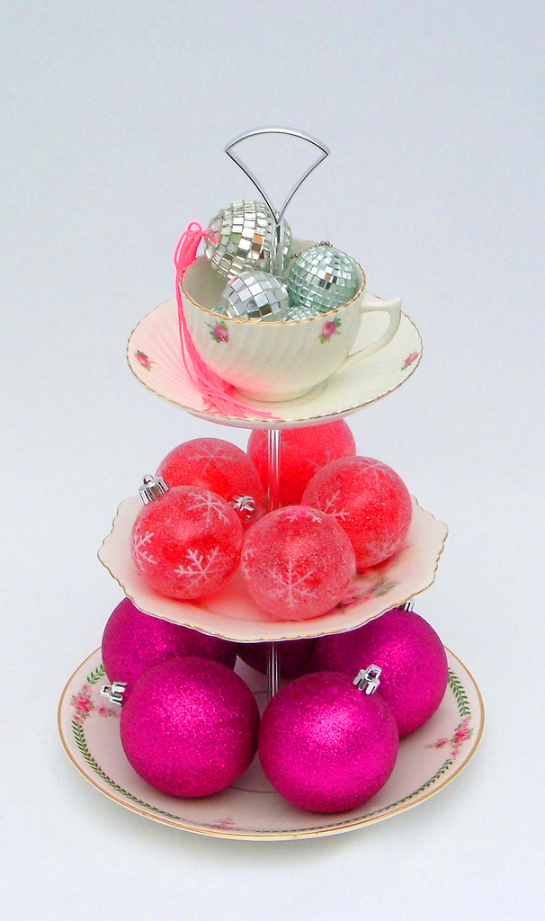 Fill a three-tiered vintage china stand with your favorite Christmas baubles. Source: Flickr User Letthemeatcake1