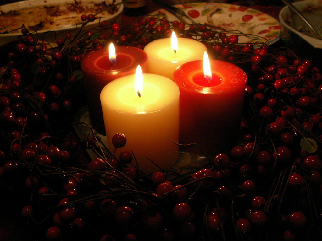 Surround a few red and white candles with bushels of cranberry. Source: Flickr User Rosefirerising
