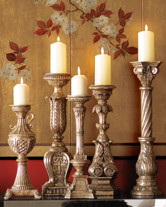 Lighting candlesticks of varying heights around the room will ensure a well-lit fête. Try the Horchow Set of Five Candlesticks ($170).