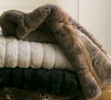 A lush blanket like the Pottery Barn Faux Fur Throw ($99) will keep you warm and ensure the sofa is never vacant.