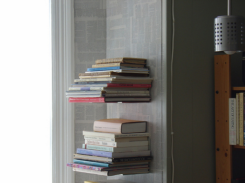 Invisible floating bookshelves dress up a corner in this home. Use it in your house for displaying your favorites. Source:  Flickr User Barb McMahon