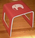 For a kids' room, or a more playful home, add this Red and White Elephant Stool ($50) to your space.