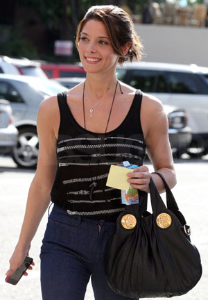 Photo of Ashley Greene Wearing Zippered Print Top in LA