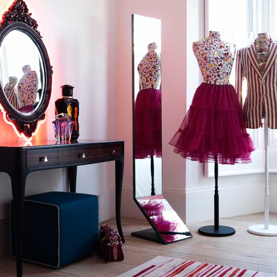 Create a dressing room area with mannequins and a slim vanity table. Use an ottoman with built-in storage to stash away shoes, blankets, or sweaters.  Source