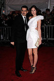 Roland Mouret and Catherine McNeil in his design