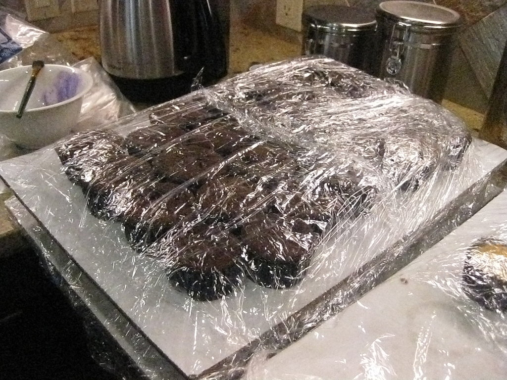 Then she transported them to a hotel (with a kitchen) in Tahoe. The cakes were placed on thick pieces of cardboard before being wrapped with several layers of plastic wrap.