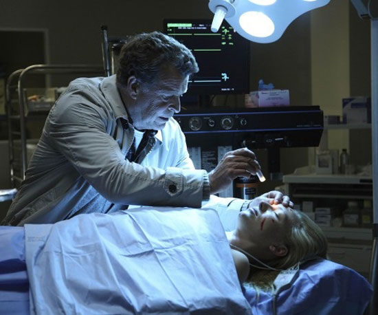 Walter works his magic on an injured Olivia. I'm sure she's okay — the show revolves around her after all — but I don't know if I'd want to put my life in Walter's hands.