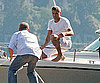 Photo Slide of George Clooney on a Boat in Lake Como