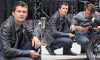 Photos of Orlando Bloom Fixing His Motorcycle in NYC