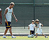 Photo Slide of David Beckham Playing Soccer with His Sons Romeo and Cruz