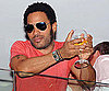 Slide Photo of Lenny Kravitz Holding Wine Over Balcony in St. Tropez