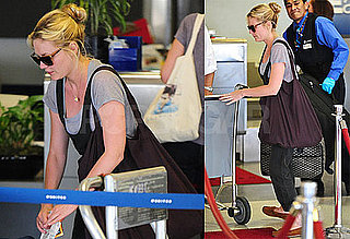 Photos of Kirsten Dunst at LAX 2009-08-23 06:00:00