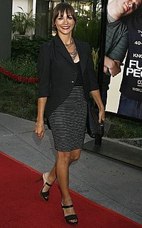 Actress Rashida Jones in Black Blazer and Striped Skirt at Funny People Premiere