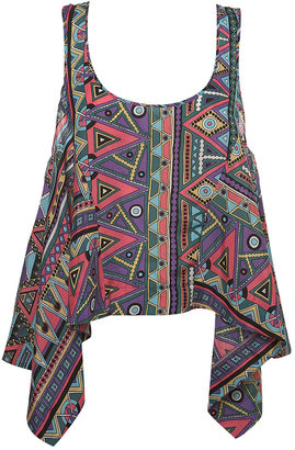 Everyone needs a little Aztec Techo in their lives. Try this Cosmic Crop Hem Vest ($65) on for size.