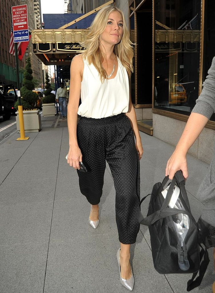 Check out how her silver stilettos dress up her quilted harem pants and white tank — dazzling!