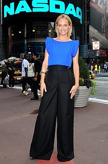 Amber Valletta Rings NASDAQ Bell in Cobalt Top and Wide-Leg Black Pants
