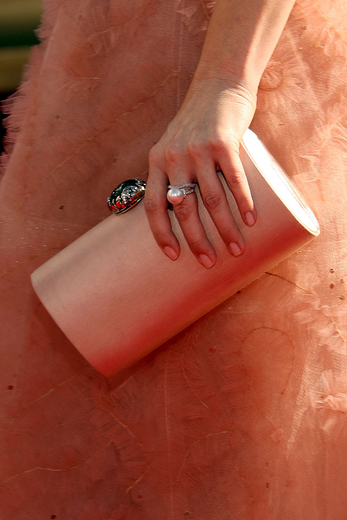 "Drew's peachy ""Drew"" clutch from Raven Kauffman Couture and pretty pearl ring."