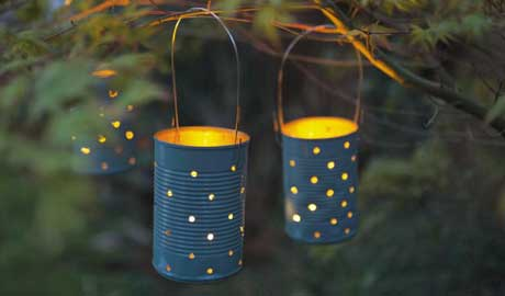 Don't let your soup cans go to waste! Wash them out and turn them into twinkling hanging lanterns for your backyard. They're completely charming when hung from tree branches. Here are the steps. Source