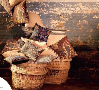 I have a few wicker baskets in my home — which I'd normally use to store magazines, books, etc. — that are nearly falling apart after years of use. Instead of tossing them, you can use them to store throws, accent pillows, and other textiles that are lightweight to prolong their lives.