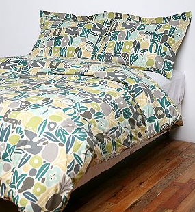 The Eden Duvet and Shams by legendary 20th century pattern maker Alexander Girard is folksy and garden-inspired.