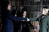 While Bellatrix Lestrange may be a straight-up evil witch, even she looks less ghastly when staged in front of some classically handsome antique books.  Source