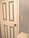 Paint the inset molding of your door with your wall paint to add depth and character. Install a crystal door knob; try eBay or salvage shops for antiques.