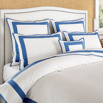 Get the same chic crispness in bed with the Percale Border Bedding ($58-378).