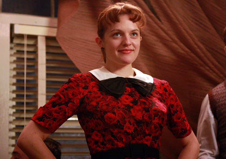 Peggy looks ready to party decked out in this charming, rose-patterned dress.