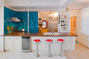 Albert Hammond Jr. introduced a little shine and color into his East Village kitchen by installing red chrome diner stools beside his countertop.   Source