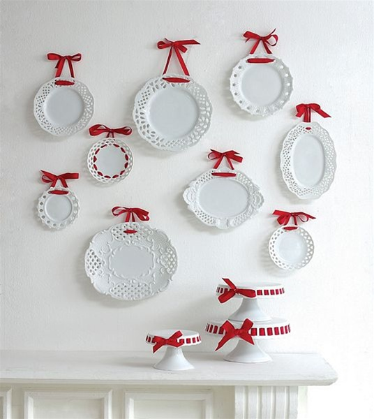 For a pretty touch, hang plates with ribbons. I love the way that a few of these lacy-edged plates have been threaded with the ribbon around the circumference of the plate. You can buy these plates here.