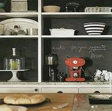 Instead of painting a poppy color on open shelving, use the space for grocery list-making in your kitchen. I love the effect, don't you? Source