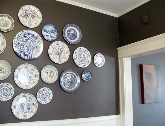 Using a strong, contrasting color as the backdrop for classic Danish blue plates is a great strategy. Here, the mocha-toned walls really make the plates pop. Tour this entire house on AT: Boston.