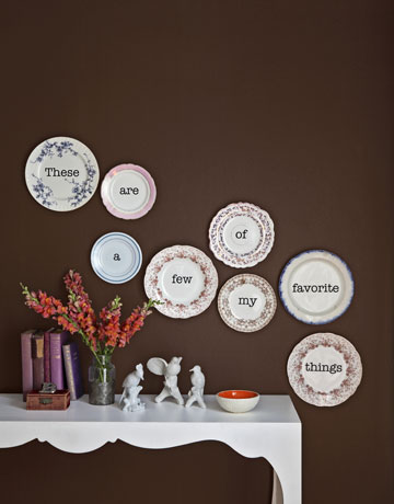 Stylist extraordinaire Paul Lowe created this charming grouping of wordy plates. Use word decals to get a similar effect. I want to try this one at home!  Source