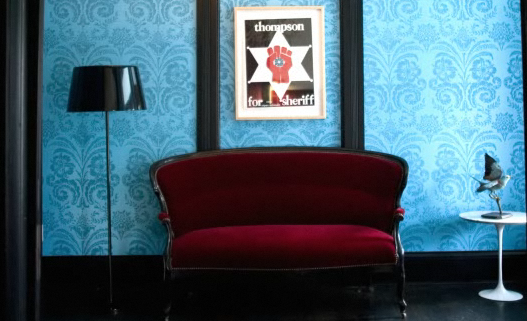 Don't be afraid to mix eras. Here, a Victorian velvet loveseat is flanked by a midcentury Saarinen table. Mix it up!