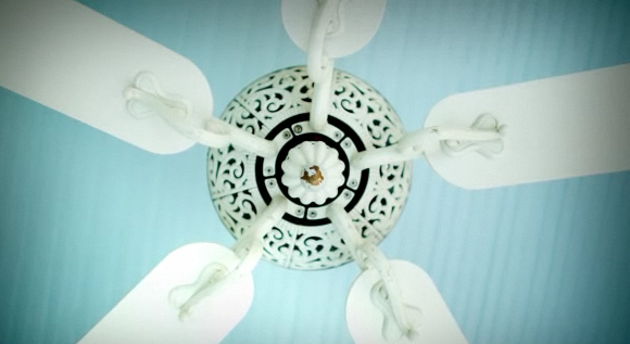 Stuck with a ceiling fan? Use a ceiling medallion to prettify the fan.