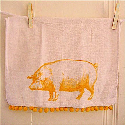 I adore the sunny yellow color of the chubby piggy on thisPig Kitchen Towel ($9), and the cotton pompom edging puts it over the top.