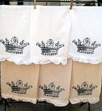 Add some shabby chic appeal to your laundry room with these Laundry Tea Stained Ruffle Tea Towels ($12).