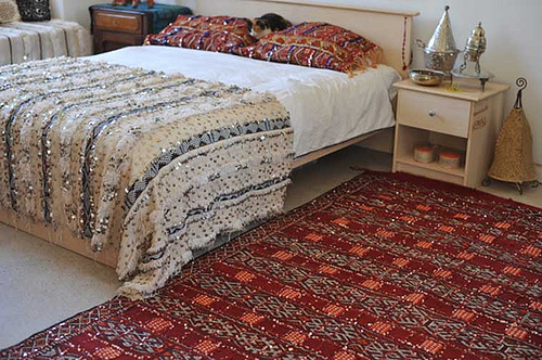 You can bring the look into your home with a handmade vintage Moroccan sequined wool kilim (inquire for price).
