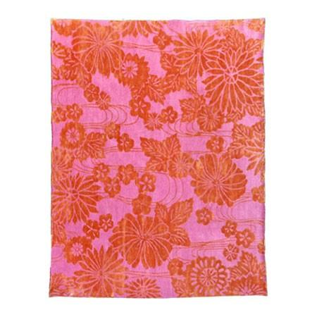 Embrace orange and pink with Emma Gardner's Flowers on Water rug ($4,875).