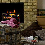 What's cozier than knitting in front of the fireplace? If you need a new hobby, Fall is a great time to start knitting. And if you get ambitious, you can try your hand at knitting this pouf. Source